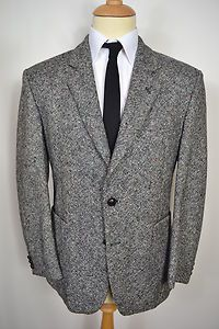 A VINTAGE 1980's ST MICHAEL PURE NEW WOOL BLAZER.    Item Description:        A MEN'S UK LARGE 42 SHORT FITTING (detailed measurements given below). Grey colour. Two buttoned (all original). Flapped pockets at the waist and a slit pocket at the left breast. Three button cuffs. Made from Pure New Wool. Black lining with three inside pockets. Genuine British vintage made by St. Michael. Excellent condition. Dry cleaned and steam pressed before being listed.