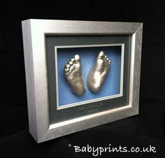 Silver grey and charcoal on blue. Silver Feet Casts. By babyprints.co.uk