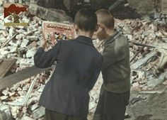 Polish boys reading Mickey Mouse while standing among the ruins of a building in Warsaw, Poland. September By Julien Bryan x Invasion Of Poland, Irish Culture, Holocaust Memorial, Military Insignia, Memorial Museum, Second World, Historical Pictures, Life Magazine, World War Two