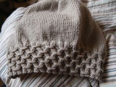 Slouchy beanie with smocked brim. Free pattern.                                                                                                                                                                                 More