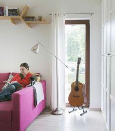 Olga has created a reading nook with a floorlamp and homemade bookshelf above the sofa #IKEAFAMILYMAGAZINE