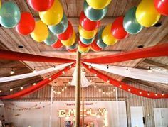 Run a threaded needle through the tied end of the balloon to string them together. I would want to do this with just green and blue balloons for a cool ceiling decoration at your grad party. -Holly