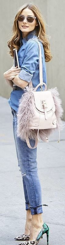 Olivia Palermo's pink backpack, clear sunglasses, blue jeans, and snake print pumps, denim on denim