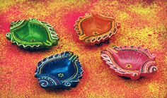 Amazon.com - Set Of 4 Traditional Earthen Hand painted Conch Shaped Diwali Diyas Lamps In Blue Pink Green & Orange Embellished With Faux Kun...