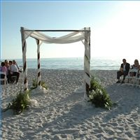 diy chuppah. wrap fabric around the poles & place flowers at the feet to decorate