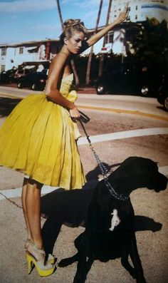 Lovely yellow color, nice match between the dress and the heels. Oh and I love how she dressed up to walk the dog :)