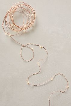 Tiny, twinkling copper Christmas lights