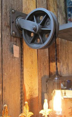 Hey, I found this really awesome Etsy listing at http://www.etsy.com/listing/150677222/zinc-pulley-wall-sconce-light