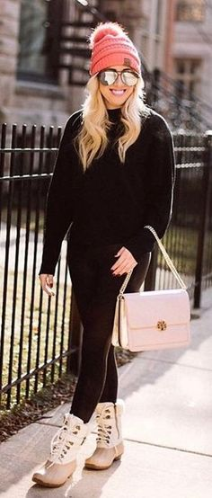 #winter #fashion / Pink Beanie / Black Knit / Pink Leather Shoulder Bag / Black Leggings / Pink Snow Boots