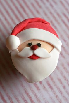 fondant santa cookies/cupcakes.    Tip: use the rolled out sheets of fondant available at craft supply stores to make this easier.