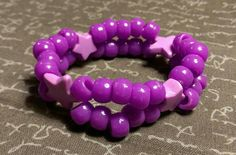 Check out this item in my Etsy shop https://www.etsy.com/listing/261531515/kandi-double-purple-lavender-stars-rave