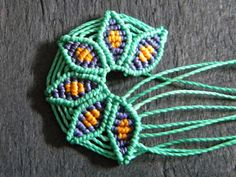 Free pattern: Macrame Flower. Great way to practice micro-macrame.