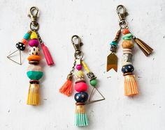Super bright handmade tassel keychains! Each keychain comes with an assortment of handmade, glass, wood and other assorted beads. Each keychain ends