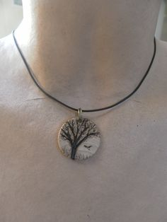 Tree and soaring hawk. Wooden pendant  necklace by REDONEbykpstack, $17.00