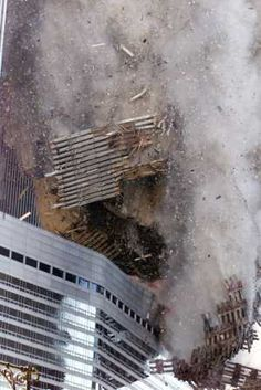 """9/11/2001 - Tower 2 crashing onto the Marriott Hotel (called the """"Vista"""") on West Street. It's main restaurant looked onto the Plaza on the mezzenine level via a whole wall of glass windows. Light & bright & good food as well."""