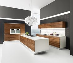 Vao luxury minimalist kitchen shown in Corian and solid wood