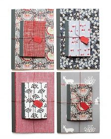 Notebooks and wooden boxes covered in fabric make great gifts. Let the recipient's taste dictate the fabric you use. For notebooks, spray the fabric with an adhesive, such as Super 77, and mount directly onto the book. Trim away the excess. For boxes, cut fabric to fit around the box, ending just below the lid, and then decoupage with Mod Podge.