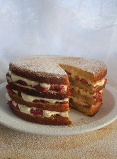 Summer's coming so why not celebrate the warmer days with a delicious vanilla cake layered with sweet balsamic strawberries and cream. Make the cake a day ahead of assembling for best results.