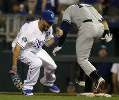 GAME 26: Friday, May 4, 2012 - Kansas City Royals first baseman Eric Hosmer, left, celebrates after forcing out New York Yankees' Alex Rodriguez during the ninth inning of a baseball game in Kansas City, Mo. The Royals defeated the Yankees 4-3. (AP Photo/Orlin Wagner)