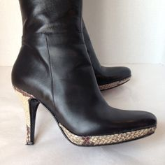 """Charles David black leather boots Gooorgeous!  Black leather boots, with snake print heel and bottom.  4"""" heel, shaft circumference at 13 1/2 with 1/2"""" extender.  14"""" tall shaft, all leather made in Italy.  Side zipper.  Minor wear in great condition.  You will absolutely love these.❤️❤️❤️  Bundle and save.  Sorry no trades, please use Offer to negotiate. Charles David Shoes Heeled Boots"""