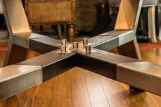 A combination of traditional rough cut maple wood timbers with the modern, straight, smooth and sharp edged satin brushed finish stainless steel and a touch of clear glass.