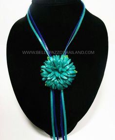 Leather flower necklace .