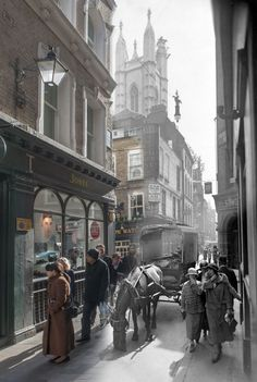 Bow Lane, off Cheapside in the City of London in 1930. The 'Ye Olde Watling' tavern was originally built just after the Great Fire of 1666. Smartly dressed women wearing hats and coats chat as they walk while in 2014 a woman in a large overcoat inspects a shop window. (Museum of London) | London then and now: Hybrid images show changing face of capital's landmarks - Yahoo News UK