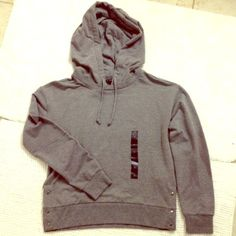 Banana Republic gray hoodie Gray drawstring hoodie from Banana Republic.  Cute metal buttons at the bottom of the sides.  New with tags and never worn Banana Republic Tops Sweatshirts & Hoodies