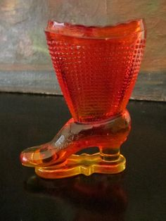 this charming pressed glass boot has multiple usage. vase, paperweight , decorative glass. made by Le Smith American glass maker. it's to be called, Amberina from depression era, and in perfect condit