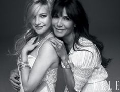 Cute pose for a mother and older daughter, or sisters.