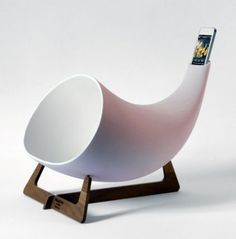 "The Megaphone is a hand-crafted ""passive amplifier"" for iPhones. It expands the music like old-school phonographs did back in the day: with an elegant, sound-amplifying horn.  From Houzz Idea Book ""6 Solutions for the iPhone Home"""