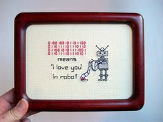 """I love you in Robot -- cute and funny cross stitch with binary """"I love you"""" for computer geeks or other cool people. $45.00, via Etsy."""