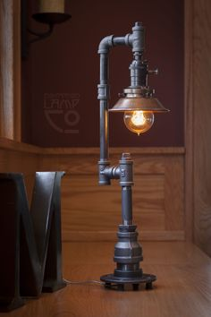 Industrial Light Fixture – Edison Bulb Pipe Lamp DIMENSIONS: Overall: high, wide, 6 deep Shade: diameter, high Base: diameter Cord: 8 long Socket: Uno Threaded Single Turn Antique Style Paddle Turn Knob Socket Bulb Equivalent Filament Dimmable Pipe Lighting, Edison Lighting, Lighting Design, Lighting Ideas, Edison Lamp, Edison Bulbs, Garage Lighting, Barn Lighting, Unique Lighting