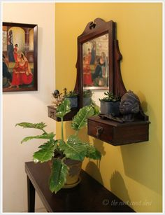 Tucked away from the cacophonous buzz of metropolitan Bengaluru, the eclectically charming home of Kanthi Prasad is truly a manifestation. Vignette with plants and old wooden mirror. Ethnic Home Decor, Indian Home Decor, Home Decor Furniture, Diy Home Decor, Arranging Furniture, Furniture Ideas, Indian Interior Design, Estilo Interior, Interior Ideas