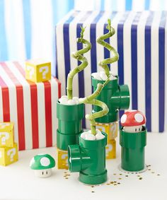 Some neat decorative ideas in here, such as painting PVC pipes green, hanging gold painted paper plates for coins.