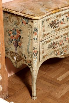 A Pair of Italian Rococo Style Painted Commodes
