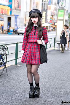 19-year-old Haruka on the street in Harajuku wearing a plaid top and skirt from Honey Cinnamon with platform shoes, a handmade bag, and Vivienne Westwood accessories.