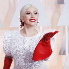 Lady Gaga is set to sing the national anthem at the Super Bowl on Sunday. The performer will sing The Star-Spangled Banner at Levi's Stadiu. Lady Gaga, Singing The National Anthem, Latex Gloves, Sweet Lady, Hollywood, Star Spangled, Super Bowl, Bell Sleeve Top, Fancy