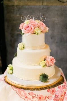 rose topped wedding cake #weddingcake #caketopper #weddingchicks http://www.weddingchicks.com/2014/03/24/shabby-chic-and-glam-wedding/