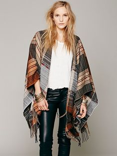 I love this Pancho!!  you are a good husband to keep the wife warm.  Free People Plaid Stitch Ruana