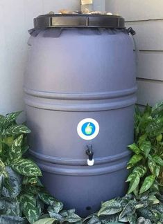 """UV protected polyethylene plastic 60-gallons 39"""" H x 24"""" Diameter 3/16"""" thick walls Overflow fitting Adaptable spigot Screw on cover Made in the USA"""