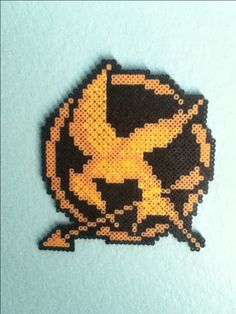 For teens DIY hunger games! I made this out of pearler beads! You can get them at any craft store, then iron it! Hama Beads Design, Diy Perler Beads, Pearler Beads, Fuse Beads, Melty Bead Patterns, Pearler Bead Patterns, Perler Patterns, Beading Patterns, Hunger Games Crafts