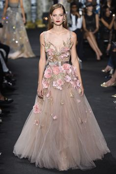 Elie Saab Fall 2016 Couture: This is a lovely ethereal gown! I could see Elle Fanning in this dress on the red carpet! She likes to go for youthful fairy like looks.