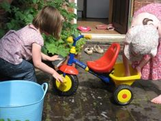 a car wash for the kids. Use real soap and sponges to wash the bikes and trikes in your school.