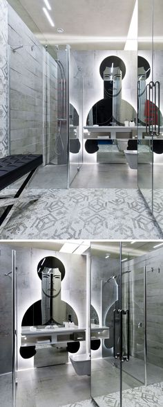 In this modern gym bathroom, mirrored doors and a custom artistic mirror reflect the light in the small space.
