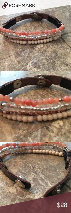 Leather and bead bracelet This is a bead and leather bracelet with a 2 position snap closure, the colors are cream coral silver and copper Jewelry Bracelets