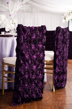 Textured purple chair covers give the reception decor a luxurious feel. Photo by Carmen Salazar Photography, Linens and Coverings: Mimi&Co Linen Rentals