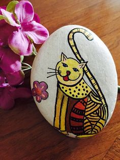 Hand Painted rock painting painted stone - Cat and Flower hand-painted on stone stone art handpainted stone