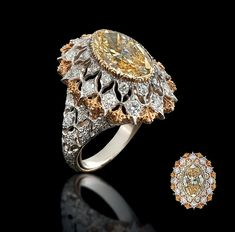 "A RARE COLOURED DIAMOND AND DIAMOND RING, BY BUCCELLATI  The marquise-cut yellow diamond within a fine oval-shaped openwork mount of two-tone stylised snowflake design to the brilliant-cut diamond detail with openwork gallery, shoulders and textured hoop engraved ""18K"" Engraved Buccellati Italy 18K"