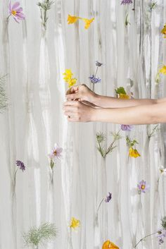 Created by Akane Moriyama and design firm Umé Studio, the knitted Draped Flowers Curtain contains over 100 pockets where fresh flowers can be placed.